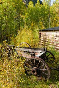 An old wagon stands next to the museum in the ghost town of Vicksburg where an audible account of the town's history can be had with the push of a button.