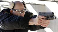 Nathan Lawless, a Grand Prairie police recruit, worked on his shooting skills at the Grand Prairie Gun Range on Wednesday.