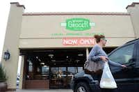 Shanna Lee of Dallas gets into her car after leaving the recently opened Green Grocer last year.ROSE BACA - neighborsgo staff photographer