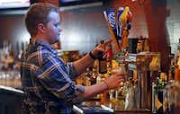 Lee Lewellen of Dallas tends bar at Grover's in Frisco on Thursday night, August 1, 2013.