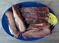 Our meal of sliced brisket and pork ribs at New Zion Missionary Baptist Church Barbecue in Huntsville. The joint has received rave, almost reverential, reviews, but we thought we were served re-warmed meat from the day before.