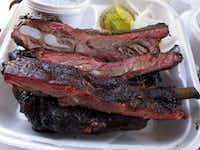 An order of pork ribs at Fargo's Pit BBQ in Bryan. Fargo's is a take-out place, so, sitting on our own chairs on the sidewalk out front, we sampled brisket, ribs, chicken and sausage. Everything was good, a rare consistency that defines a great joint.