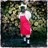Pitmaster and owner Leon O'Neal stands in front of a stack of oak wood outside of Leon's World's Finest In & Out Barbeque in Galveston on June 2, 2012, our first stop on the second day of the Gulf Coast BBQ Tour.