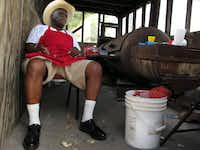 Pitmaster and owner Leon O'Neal sits in his old smoker house at Leon's World's Finest In & Out Barbeque in Galveston. In 2008, Hurricane Ike's storm surge had been 7 feet deep in the room, but O'Neal was cooking BBQ again days later. He cleaned up the smoker, fired it up and started cooking barbecue for repair crews. Soon, he said, people smelled the smoke and he had cars lined up around the block.