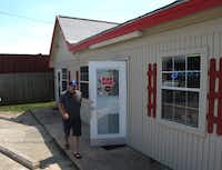 Posse member Phil Lamb exits Virgie's Bar-B-Que in Houston on June 2, 2012, our seventh stop on the Gulf BBQ Tour.