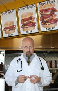"""Heart Attack Grill owner """"Dr."""" Jon Basso, who says he previously ran Jenny Craig franchises in Oklahoma and founded a chain of gyms, now claims he's fighting obesity with """"shock value""""– by feeding the (supersized) masses."""
