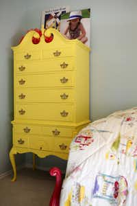 The high-boy chest of drawers, a family heirloom, gets fresh style with a coat of lemon yellow paint.