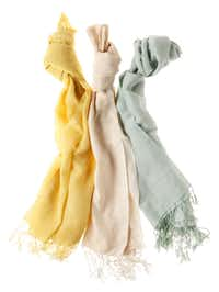 Wrap it: Cotton, linen and silk scarves in aqua, hot pink, turquoise and natural hues are special accessories for spring dresses. $61 to $98 at Mary Cates and Co., Dallas.