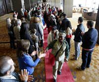 Hundreds of volunteers greet 500 homeless people at the Omni Dallas Hotel on Monday