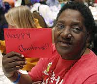 """Carol """"Mama"""" Hawkins, 58, is all smiles after receiving a Christmas card at her table during lunch at Omni Dallas Hotel on Monday."""