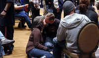 Alice Cowden kisses Shane Goodmon as they wait with other homeless people to have lunch at the Omni Dallas Hotel on Monday.