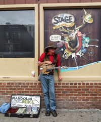 Busker Mandolin Mike takes a break on Honky Tonk Row.Robin Soslow  -  Special Contributor