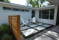 Modern Craft added a semi-private courtyard at the front entrance. The couple chose the screen details based on Houzz.com photos.