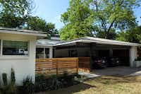 The biggest challenge in the renovation process was the carport. Because the residence is within a historic preservation overlay district, strict guidelines had to be followed when completing the redesign. Neither a gate nor door could cover the area's entrance. Wood was added, along with exposed steelwork, and the carport met required standards.