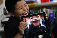 Isaac Sigala laughed at the distorted photo of himself that he took with one of the iPads received by fourth-graders last week at Rutherford Elementary in Mesquite.