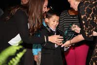A young student accepts a Crystal first place award at the 2014 Irving Celebration of Excellence events at Irving High School.Billy Rudolph/Irving ISD