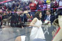 With the ice reflected in the glass, fans and cheerleaders gave an ovation as Mark and Mary left as newlyweds.Matthew Busch  -  Staff Photographer
