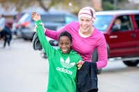 Shannon Cox (right) and her Haitian-born son, Andre, helped inspire the nonprofit, Haitian Roots, which Cox helped found in 2005. Entry fees from the inaugural Thanks Giving Hope 5K and Fun Run will fund at least 20 scholarships for Haitian children through the nonprofit.Photo submitted by ANGELA LOWRY PHOTOGRAPHY