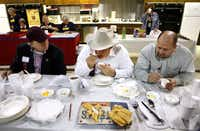 Judges (from left) Billy Hines, Frank Wood and Mike Rogers taste tamales during the Great American Spam Championship at the State Fair of Texas. This is the 75th anniversary of Spam.