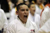 Daniel Wallis, 13, sounded off during a karate demonstration at the Irving district's Austin Middle School. Parents say the program enhances confidence, not just fitness.