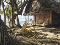 Kosrae Village Ecolodge (KVR, as the locals call it), has nine traditional palm thatch cottages just feet from the ocean.