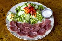 Yellowfin tuna sasami, fresh raw fish served with a green salad.