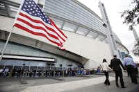 People wait in line to enter the stadium before a memorial service for Chris Kyle at Cowboys Stadium in Arlington on February 11, 2013.