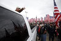 Larry Key, Deputy State Captain of the North Texas Region instructs the Patriot Guard Riders of how they will be entering the stadium before a memorial service for Chris Kyle at Cowboys Stadium in Arlington on February 11, 2013.