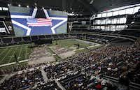 Chris Kyle's casket rests on the Cowboys star on the 50-yard-line at Cowboys Stadium during a memorial service for Chris Kyle in Arlington on February 11, 2013.