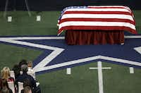 Taya Kyle, top left, wife of former Navy SEAL Chris Kyle talks to her son during the Memorial Service on Monday, February 11, 2013 at Cowboys Stadium in Arlington, Texas.