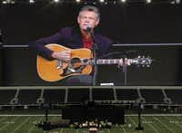 Randy Travis sings Amazing Grace during the Memorial Service for former Navy SEAL Chris Kyle on Monday, February 11, 2013 at Cowboys Stadium in Arlington, Texas.