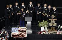 Taya Kyle, wife of former Navy SEAL Chris Kyle wipes her face the during memorial service on Monday, February 11, 2013 at Cowboys Stadium in Arlington, Texas.