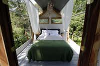 The bedroom of the Majestic Oak Treehouse at Savannah Meadows, an eco-tourism lavender farm in Celeste.Sonya Hebert-Schwartz - Staff Photographer