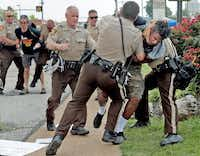 <bold>Police tackled a man</bold> in Ferguson, Mo., on Monday who had exchanged words with them after being told to keep moving as he walked past a group that had assembled nearby.Laurie Skrivan - Dispatch