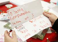 Santa's friends in the U.S. Postal Service's Dallas district answer more than 5,000 letters a year.