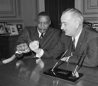 Heavyweight boxing champion Sonny Liston and Vice President Lyndon Johnson compared fists at the Capitol in March 1963.