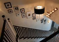 Stairs with hardwood treads and a simple balustrade lead upstairs to a master bedroom, nursery and screened porch, a favorite hangout of the owners.