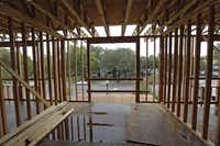 A Magnolia Property construction site in Oak Cliff stood ready for work to resume after a rainstorm recently.