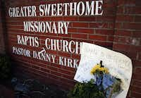 Memorials were left in front of the church after Monday's slaying.
