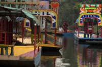 In Xochimilco, busy markets stand side by side with colonial churches. On weekdays, children ride to school in boats pushed by poles along the quiet canals.Rebecca Blackwell  -  AP