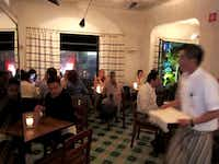 The tiny dining room at Maximo Bistrot in the Colonia Roma neighborhood of Mexico City attracts foodies from around the city.