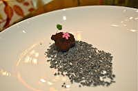 Chef Pablo Pe?alosa Najera creates a sinfully delicious cacao-coated foie gras truffle over a bed of toasted sweet sesame at Morimoto Mexico City.