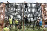 Participants in the Original Mud Run climb a web wall during the event in Fort Worth on April 14, 2012.