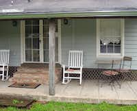 The back porch of Vera's Guest House in Natchitoches, La., has rockers for relaxing and taking in the view over Cane River Lake.
