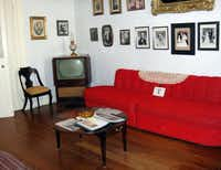 At Oakland Plantation outside Natchitoches, La., the main house has been restored to how it was in the 1960s -- thus the red couch and vintage TV set along a wall that also includes family portraits going back generations.
