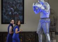 Courtney Emich Spellicy and Amanda Green checked out the live boxing statue at FightNight 25. The event has grown into a fundraising phenomenon for The Real Estate Council and its foundation.