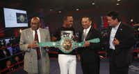 Former boxers Curtis Cokes, Sugar Ray Leonard, Paulie Ayala and Roberto Duran held a signed World Boxing Council championship belt that was auctioned off for $14,000.