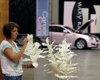 Aimee Henderson of Mary Kay prepared a display at the Dallas Convention Center on Tuesday ahead of the cosmetics company's annual gathering, which begins today.