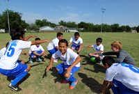 Members of the soccer team from Pershing Elementary School warmed up before a DISD championship match Wednesday at Benito Juarez Field in West Dallas near the Margaret Hunt Hill Bridge. The area was ranked one of the best places for bargain homes.