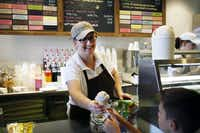 Co-owner Patti McCrary Otte hands an ice cream cone to a customer at Sweet Firefly on Wednesday, Oct. 3, 2012, in Richardson. The shop is named for Otte's daughter, who died when she was 2 -- her nickname was Sweet Firefly.